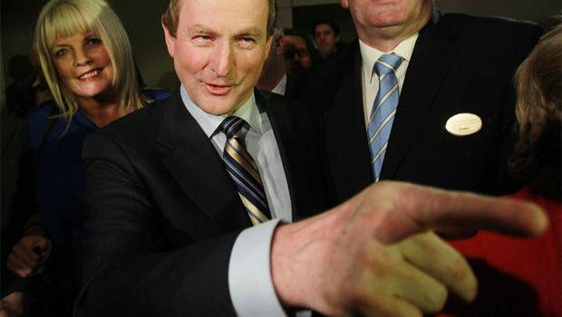 Enda Kenny leads Fine Gael in a party rally. Photo: PA