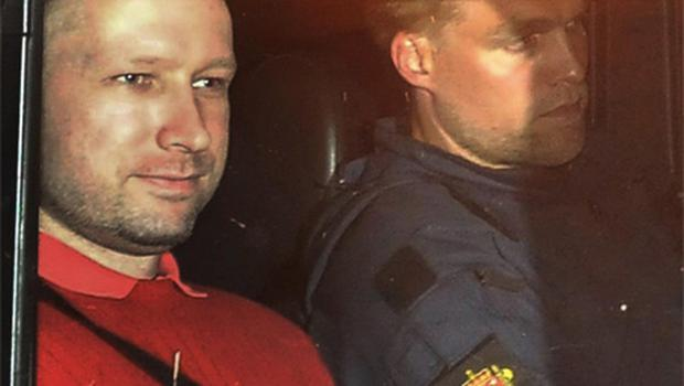 Anders Behring Breivik , left, sits in an armored police vehicle after leaving the courthouse following a hearing in Oslo Monday July 25. Photo: PA