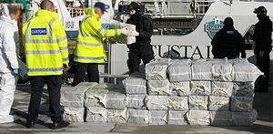 Gardai and Customs officers unload the cocaine from the catamaran 'Lucky Day' back in July 2007