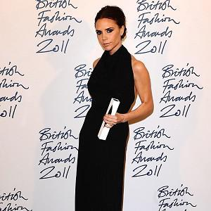 Victoria Beckham steps in as the model when creating her fashion designs