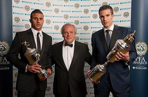 Silverlined success: Arsenal's star forward Robin van Persie (right) shows off his Player of the Year award with young player of the year Kyle Walker. Photo: PA