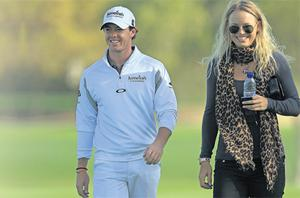 Rory McIlroy has been dealt a hand of aces in his relationship with girlfriend and tennis star Caroline Wozniacki, according to Aussie legend Greg Norman