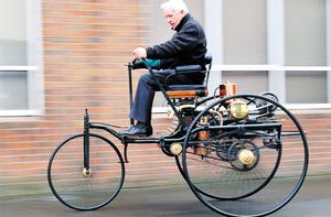 THE BEGINNINGS: Denis Dowdall drives a re-created prototype of the first car, which was invented by Karl Benz