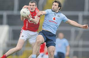 Cork's Graham Canty battles for possession with Dublin's Bryan Cullen at Pairc Ui Chaoimh yesterday
