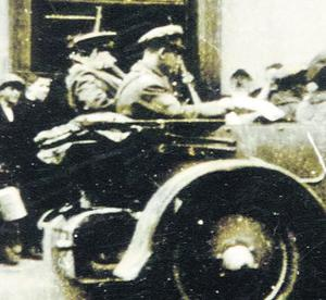 In this picture taken by Agnes Hurley, Michael Collins is seen at the rear of the car on the left just hours before his death
