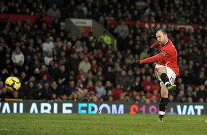Wayne Rooney scores his second goal during the match against Hull City  Photo: Getty Images