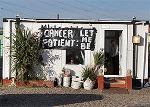 A sign hangs from a home inside the Dale Farm Traveller site before the eviction took place