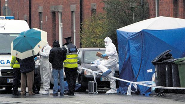 Gardai at the scene following the discovery of a body of a woman in large holdall at St David's Terrace, Blackhorse Avenue, Dublin. Photo: Collins