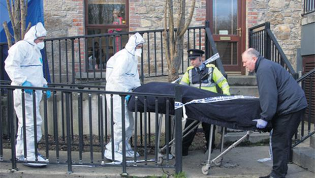 Anthony Fallon's remains are removed from the stairwell where his badly beaten body was found
