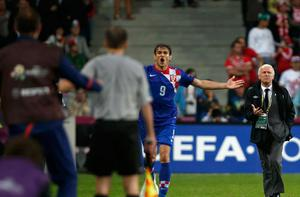 Ireland's coach Giovanni Trapattoni (R) reacts as Croatia's Nikica Jelavic (C) celebrates his goal