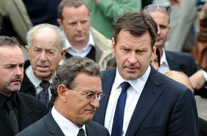 Nick Faldo (R) leaves the funeral service. Photo: Getty Images