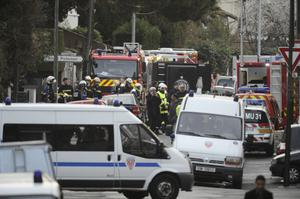 French policemen and firefighters stand as members of the RAID special police forces unit are still laying siege to the apartment block where Mohamed Merah, the man suspected of a series of deadly shootings, was holed up, on March 22, 2012 in Toulouse, southwestern France. Suspected jihadi serial killer Mohamed Merah is a 23-year-old French petty criminal of Algerian origin who spent time in Pakistan and Afghanistan and claims to be an Al-Qaeda militant. AFP PHOTO LIONEL BONAVENTURE (Photo credit should read LIONEL BONAVENTURE/AFP/Getty Images)