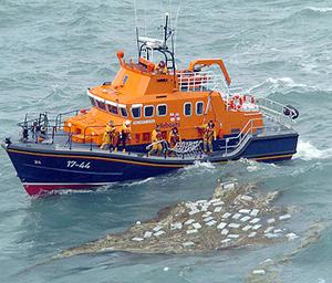 The Baltimore lifeboat recovering some of the huge haul of drugs that was washed ashore near Mizen Head