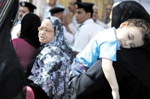 Women wait outside a polling station during presidential elections in Cairo. Photo: Reuters