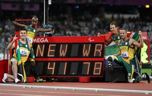 The South Africa team of Oscar Pistorius (right), Samkelo Radbee, Zivan Smith and Arnu Foure celebrate winning Gold in a world record time during the Men's 4x100m - T42-T46 Final at the Olympic Stadium, London.  Photo: PA