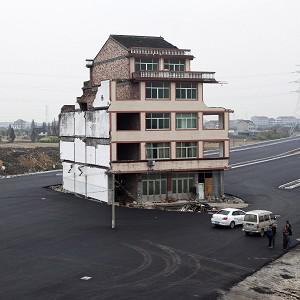 A five-storey home is all that remains of a neighbourhood which was vacated to make room for a main road near Wenling, eastern China. (AP)