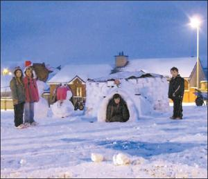 Local children play in a winter wonderland after residents of Old Coach Avenue in Millstreet constructed an igloo at the height of the snow. Credit: Photo by Sean Radley