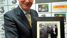 Giovanni Trapattoni was presented with a photograph of himself when he was assistant manager of AC Milan, with manager Nereo Rocco, on their visit to St. Mels Park, Athlone, for their UEFA Cup, 2nd Round, 1st leg, game against Athlone Town in 1975. Photo: David Maher / Sportsfile