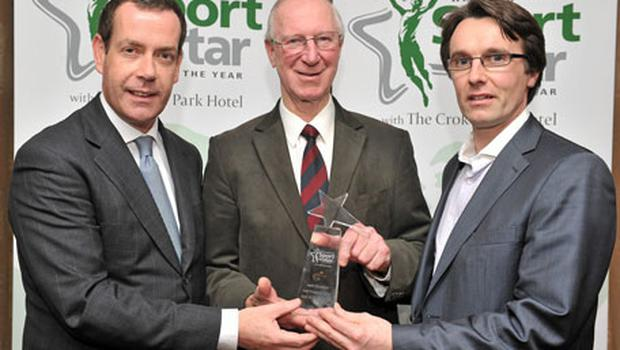 Former Republic of Ireland manager Jack Charlton (C) receives the Hall of Fame award from Bill Walshe (L), CEO The Doyle collection, and Joe Webb, Chief Executive of Independent News and Media Ireland, at the Irish Independent / Croke Park Hotel Sportstar of the Year Luncheon yesterday.