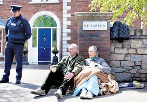 Asta and her husband Brendan sit outside the house having been refused re-entry to gather some of their belongings