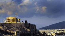 Dark clouds gathering over Greece: Acropolis hill in Athens
