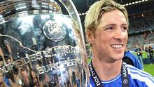 Fernando Torres of Chelsea holds the Champions League trophy after victory over Bayern Munich. Photo: Reuters