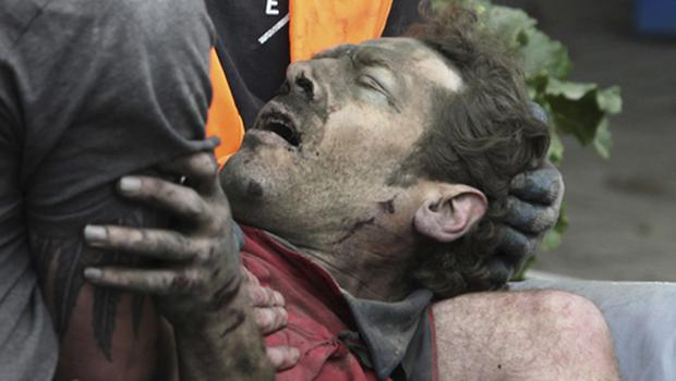 A man is seen being pulled from the rubble after the earthquake in Christchurch yesterday