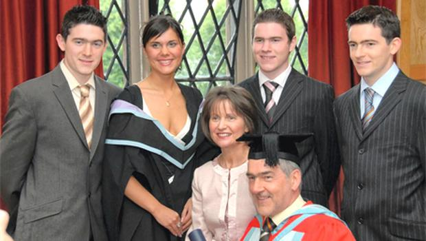 Michaela with her dad at Queen's University Belfast in 2006 after he received an honorary doctorate for services to Gaelic football and she received a bachelor of education