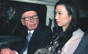 Rupert Murdoch, left, looks to his wife Wendi Deng Murdoch as they are driven from the Royal Courts of Justice in London after he gave evidence to the Leveson Inquiry yesterday.