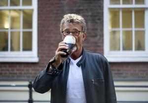 Eddie Jordan enjoys a pint of Guinness at the Toucan Bar in Soho, London, after learning he is to be made an Officer of the British Empire (OBE) in recognition for his services to charity and motor racing. PRESS ASSOCIATION Photo. Picture date: Wednesday March 28, 2012. Photo credit should read: Anthony Devlin/PA Wire