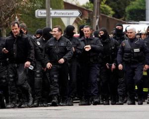 French special unit policemen leave the scene after the assault during whichMohamed Merah was killed.