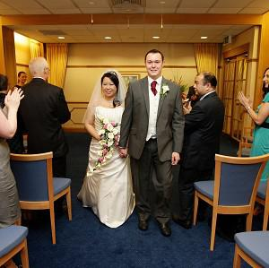 Steven Higham and Ngaryan Li after their wedding at the Manchester Register Office on 10/10/10