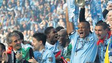 Manchester City's captain Vincent Kompany lifts the Premier League trophy after a dramatic final day of the season