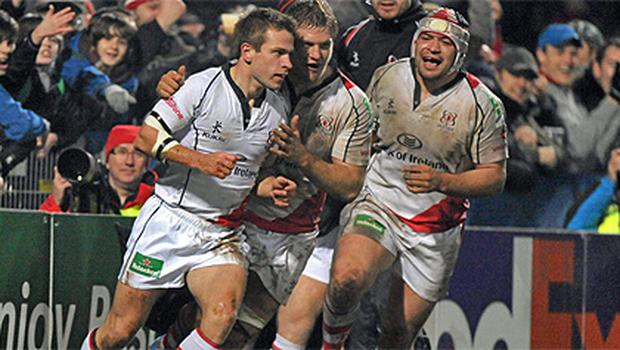 Paul Marshall  celebrates with Chris Henry after scoring his Ulster's fourth try