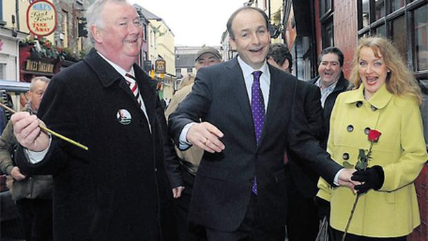 Fianna Fail leader Micheal Martin gives a rose to his cousin Sheila Martin as he went on a walkabout with John O'Donoghue in Killarney at the weekend
