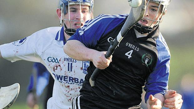 Ciaran Quirke of Thurles CBS attempts to block Nenagh CBS's Podge Shanahan
