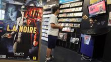 Carlos Martinez plays the Mortal Kombat Vs DC Universe video game at Play n Trade video game store June 27 in Miami, Florida. On Monday the United States Supreme Court struck down a California law banning the sale of violent video games to minors. Photo: Getty Images