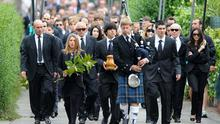 Javier Ballesteros (C) carries the ashes of his father Seve Ballesteros during the funeral service held for the legendary Spanish golfer in Pedrena, Spain. Photo: Getty Images