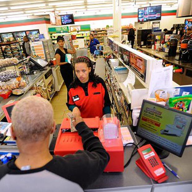 A shop assistant sells lottery tickets at a Baltimore 7-Eleven store where one of the winning tickets was bought