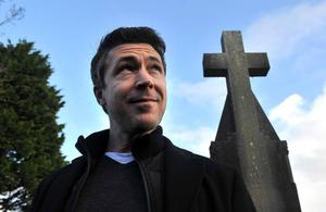 Aidan Gillen star of 'Love / Hate' and The Wire pictured outside St. James's Church in Dingle, County Kerry  the venue where he will present 'Other Voices' this week.