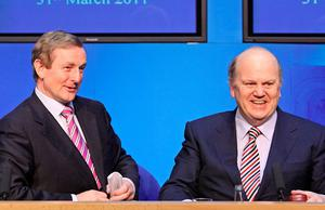 IN DENIAL: Enda Kenny and Michael Noonan sought to downplay the bombshell news that ESM funds will not be allowed to sort out the sins of our bankers