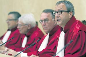 The president of the German Constitutional Court Andreas Vosskuhle (left) pronounces judgment on euro bailouts at the German Constitutional Court in Karlsruhe yesterday