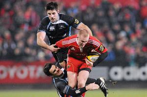 Keith Earls is tackled by Max Evans and Johnnie Beattie in Musgrave Park last night. Photo: Diarmuid Greene/Sportsfile
