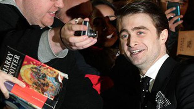 Daniel Radcliffe meets fans as he arrives for the world premiere of The Woman In Black