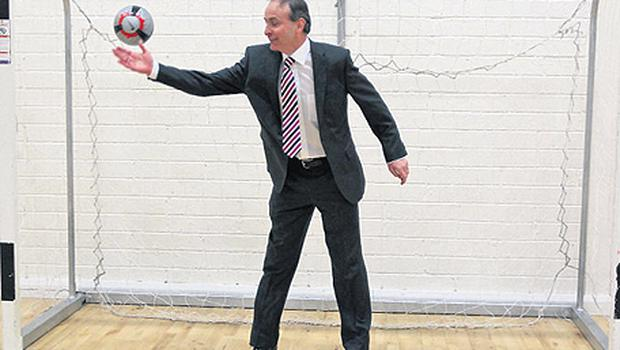 Fianna Fail leader Micheal Martin tried to stop a shot when he visited Fettercairn Community Centre, Tallaght, Dublin yesterday evening