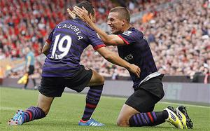 New boys: Arsenal's immediate future rests on new boys such as Lukas Podolski and Santi Cazorla  Photo: PA