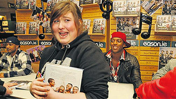 Chantelle Ward gets her 16th birthday wish by meeting the boys at Eason's in O'Connell Street, Dublin yesterday