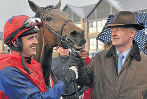 Ruby Walsh and trainer Willie Mullins celebrate after winning the Ladbrokes.com World Series Hurdle with Quevega at Punchestown. Photo: Sportsfile