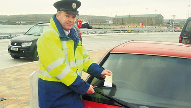 Martin Mannion, community warden with Galway County Council, issues the first ever traffic violation ticket on Inis Mor, the largest of the Aran Islands, last Monday