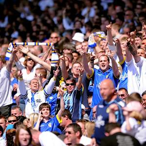 Leeds United has banned a 63-year-old woman after a pitch invasion at the club's last home match of the previous season